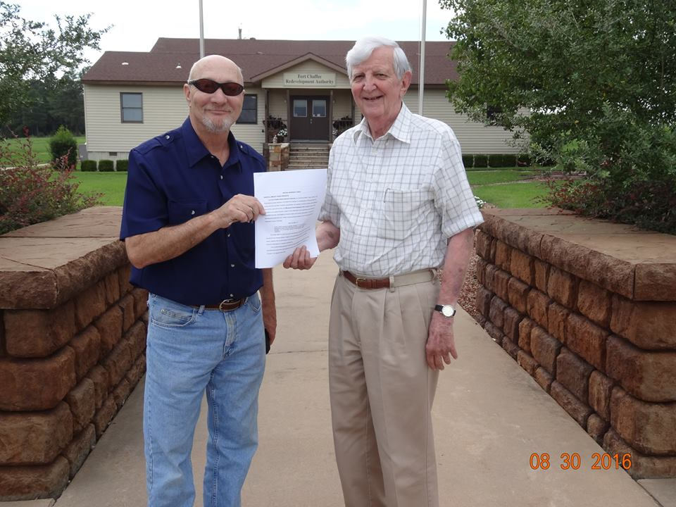 HWT Museum Board Members James Reddick and Bob Worley with deed